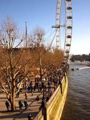 People enjoying a sunny Sunday along Thames River - LONDON, England